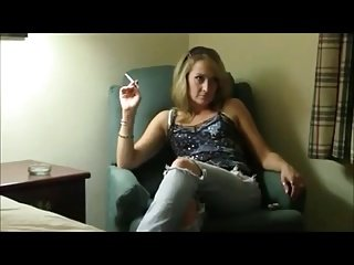 Mature blonde smoking in hotel