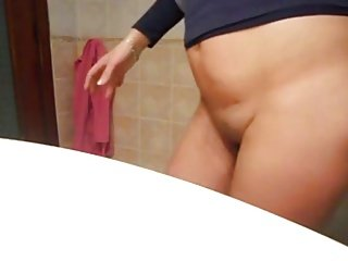 Mature dildo in the bathroom
