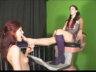 Mistress feet kissed by girl