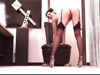 Horny secretary removes glasses and masturbates