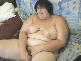 German BBW jams a dildo in herself