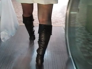 Fishnet stockings upskirt on escalator