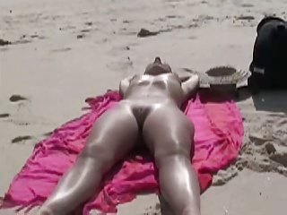 Voyeur woman on beach
