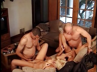 Four horny ladies fucking strap on dildo