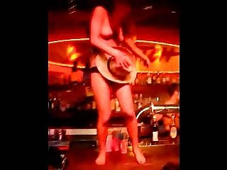 Young girl gets on stage shy at first then strips