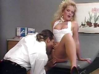 Big hair blonde gets fuck from behind in doctor's office