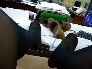 Show pantyhose legs in office
