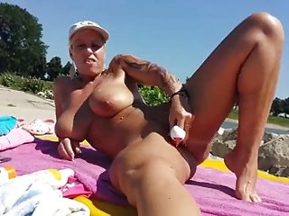 Nude Beach - Big Boob Mature Plays Up