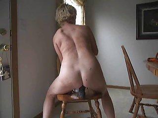 sittin on a blak dildo