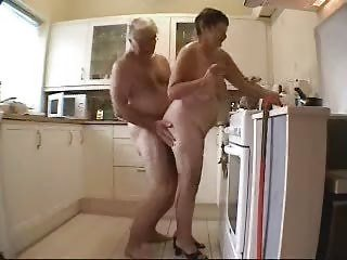 Granny and grandpa having fun in the kitchen