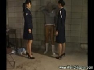 Two female asian cops humiliate prisoner