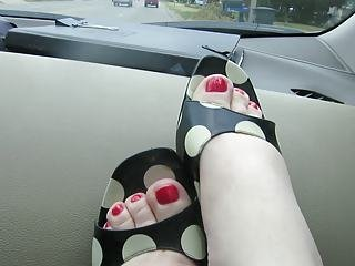 putting on my antonio melini red thongs with my new pedicure