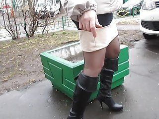 Black leather boots and stockings upskirt