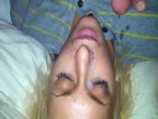 Cumshot on Haydens face while shes sleeping