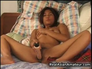 Naughty asian girlfriend forces dildo