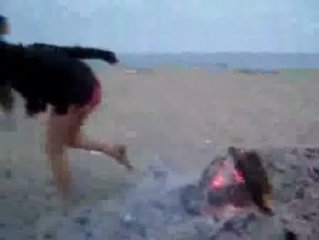 drunken teen peeing off thge fire at the beach