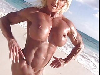 Naked muscle mature woman on the beach