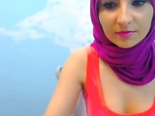Hot Arab babe dancing with hijab on.