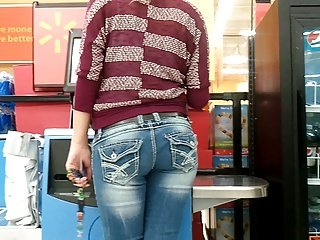 Beautiful teen in jeans candid at self checkout