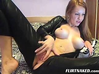 Model in Leather Suit Masturbating