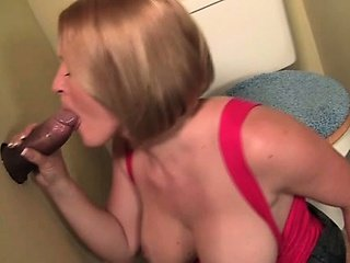 Sex starved blonde giving tugjob and blow job on gloryhole
