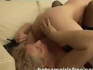 Fat woman and sexy girl on sofa