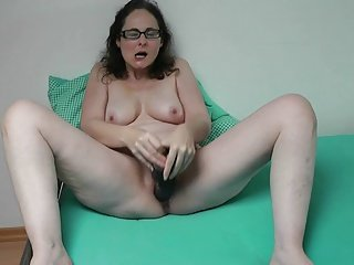 German Hot lady playing with her huge dildo