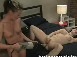Girlfriends use machine dildos on each others