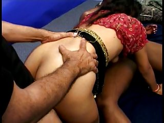 Hot Indian whore in red blouse fucks four dicks on floor