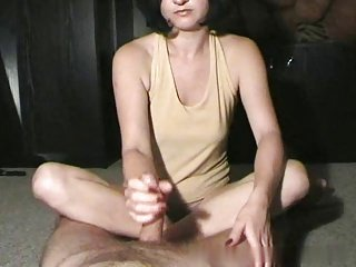 The Art of Handjob-yellow top, sitting cross-legged