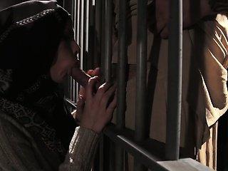 Muslim babe sucking dick through jail bars