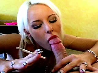 Peroxide blond tramp Angel Couture smoking and sucking a large boner