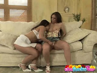 Two adorable brunette lesbians fingering their petite pussies
