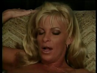 Randy blonde hot lady on sofa gets her pussy licked by young black guy then fucks