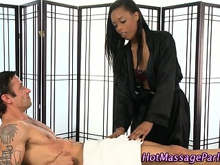 Black massage babe sucks her client