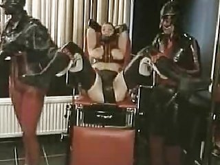 Lady in Latex has internal dildo pants removed