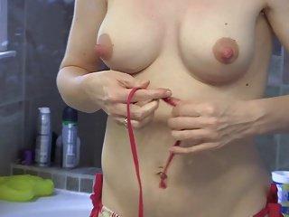Wife Putting on Bikini