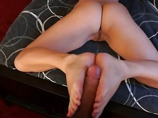 Girl Gives Her Man A Sexy Footjob