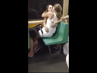 Teen Girls Kissing in Subway