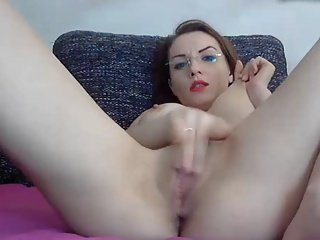Hottie in glasses rubs pussy and puts on a huge squirt show