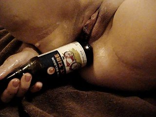 woman putting bottle in pussy and ass
