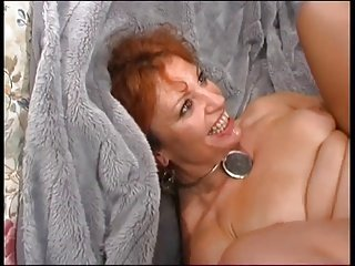 Mature Redhead Enjoys Young Dick
