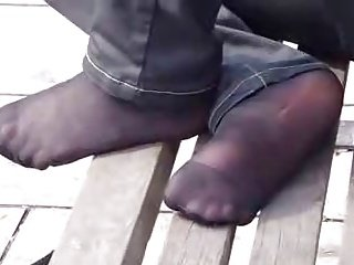Candid nylon feet in the park