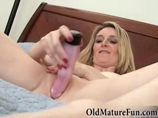 Mature blonde masturbating with vibrator