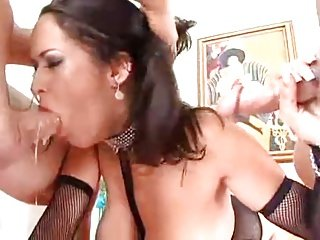 Busty brunette facefucked by two dicks