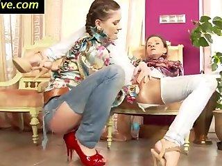Classy clothed slut rides fist