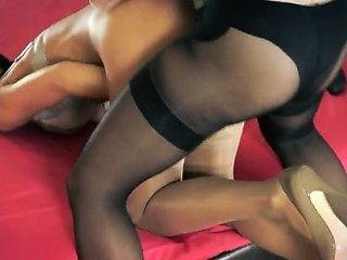 Two hot fine lesbians using strap