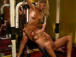Lesbian having quality time in a gym
