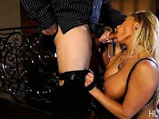 Stunning blonde on her knees sucking dick