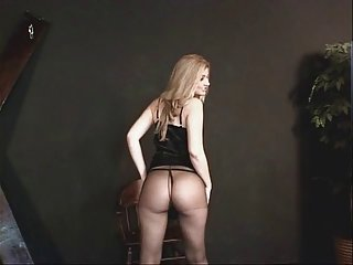 Small tits hottie in a black dress  and nylons getting ready for some action